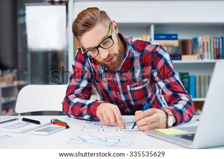 Web designer creating layout for new startup website - stock photo