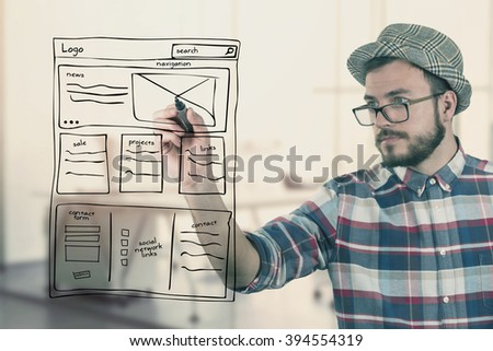 web designer drawing website development wireframe at office - stock photo