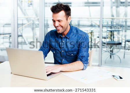 Web designer putting his new aplication to test - stock photo