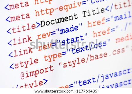 Web page HTML source code with document title, metadata description and links monitor screenshot diagonal view, small depth of sharpness