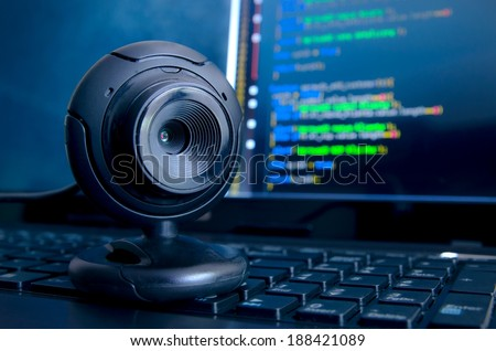 Web surveillance camera. Spying and safety on the Internet - stock photo