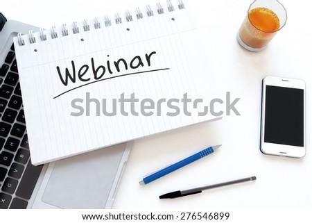 Webinar - handwritten text in a notebook on a desk - 3d render illustration. - stock photo
