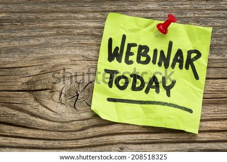 webinar today reminder - handwriting on a green sticky note against grained and knotted wood board - stock photo
