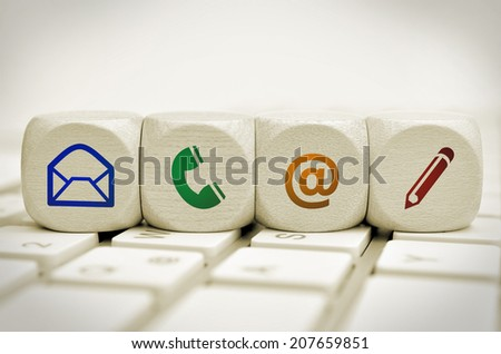Website and Internet contact us page concept with colered icons on keyboard - stock photo