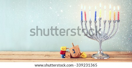 website banner image of of jewish holiday Hanukkah with menorah (traditional Candelabra). retro filtered - stock photo
