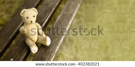 Website banner of a toy bear as giving his paw - stock photo
