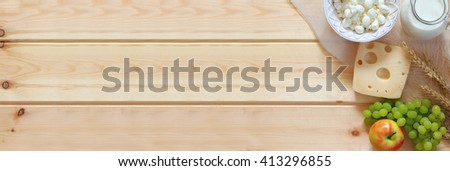 website banner of dairy products and fruits on wooden background. Symbols of jewish holiday - Shavuot  - stock photo
