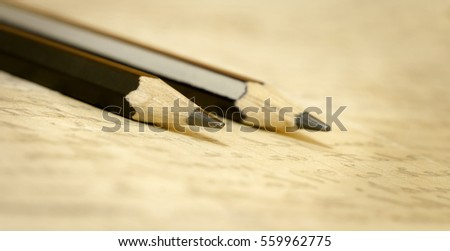 Website banner of pencils and handwriting letter