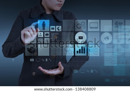 Website designer working with the new computer interface as design concept - stock photo
