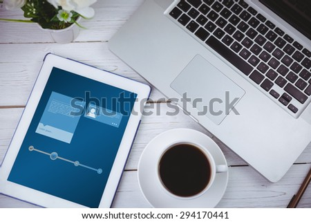 Website interface against tablet and laptop on table