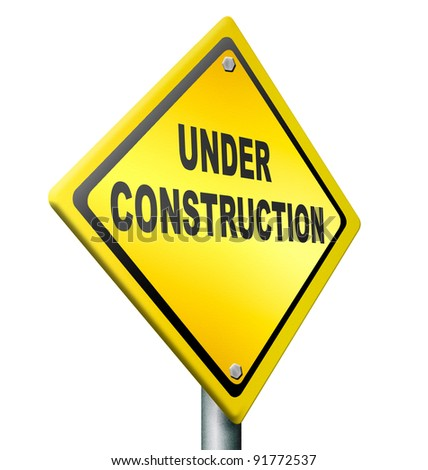 website under construction web repair or building internet page, yellow warning road sign - stock photo