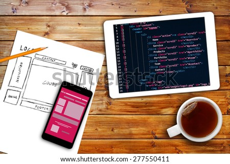 website wireframe sketch and programming code on digital tablet - stock photo