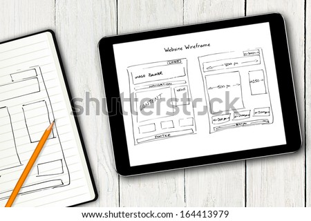 website wireframe sketch on digital tablet screen - stock photo