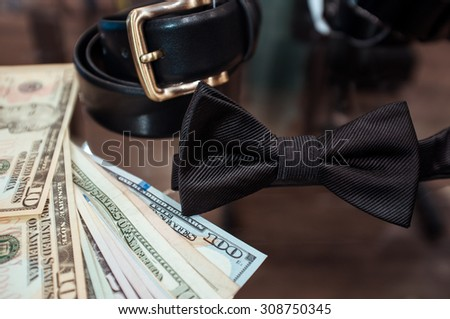Wedding accessories for the groom (a belt and a tie) in shop of fashionable men's wear and dollars - stock photo