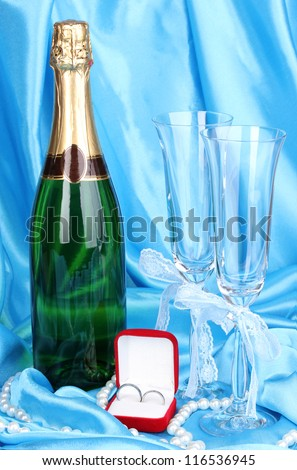 Wedding accessories on blue cloth background - stock photo