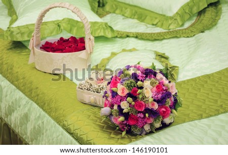 Wedding accessories on the bedspread - stock photo