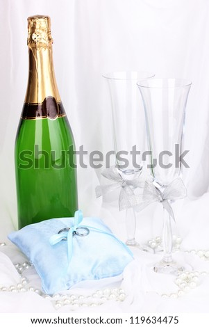 Wedding accessories on white cloth background - stock photo