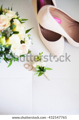 Wedding accessories: shoes, rings, boutonnieres, perfume on a white background