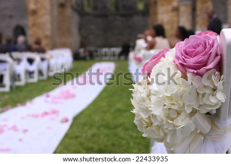 Wedding aisle and bouquet with unidentifiable guest
