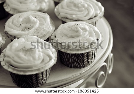 Wedding and Birthday Cupcakes and Cakes on a tray. (BW) - stock photo