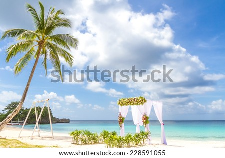 wedding arch and set up on beach, tropical outdoor wedding cabana on beach - stock photo