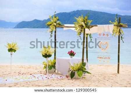 Wedding arch at tropical beach - stock photo
