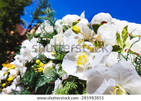 wedding arch decorated outdoors orchid flowers. Arch is located in the forest - stock photo