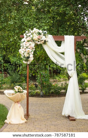 Wedding arch decorated fabric fresh flowers stock photo edit now wedding arch decorated with fabric and fresh flowers junglespirit Choice Image