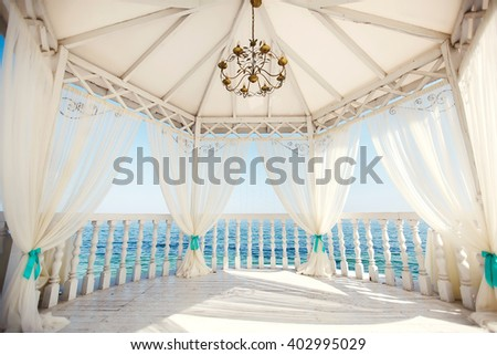 Wedding arch in Tiffany color on the beach. - stock photo