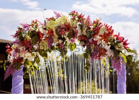 Wedding arch red blue purple white stock photo royalty free wedding arch of red blue purple and white flowers marriage registration the mightylinksfo