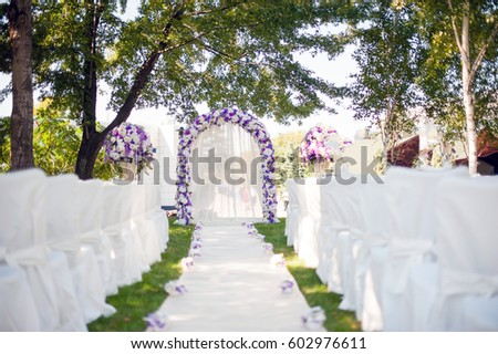 Wedding Arch On The Nature Of White And Purple Shades