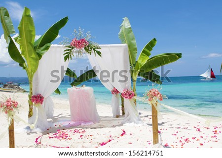 wedding arch - tent - decorated with flowers on beach, tropical wedding ceremony set up