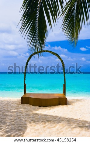 Wedding archway at tropical beach - holiday background - stock photo