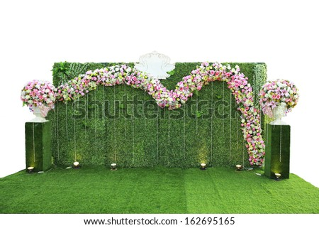 Wedding archway with flowers arranged in park for a wedding  - stock photo