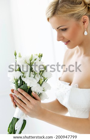 Wedding. Attractive bride with beautiful bouquet