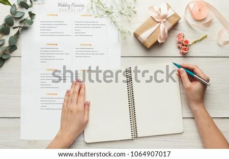 wedding background checklist calendar female hands stock photo