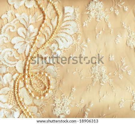 Wedding background with cream silky decoration accessories, lace and pearls - stock photo