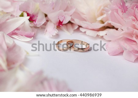 wedding background with peonies and rings for invitations and cards - stock photo