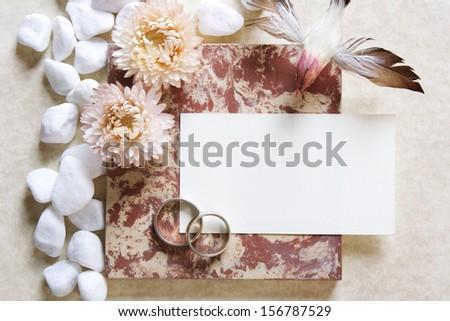 Wedding background with wedding bands on the decorative stone - stock photo
