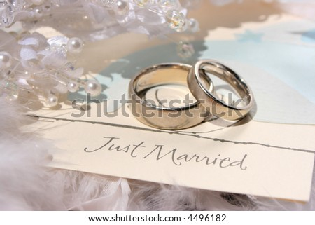 "wedding bands sitting on card saying ""Just married"""