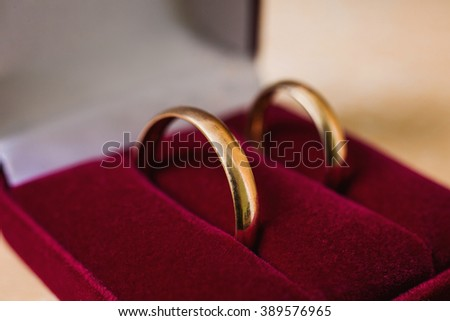 wedding bands, wedding rings in the red box, wedding jewelry, wedding preparation - stock photo