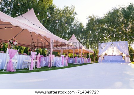 Wedding Banquet Outdoor In Marquees On Lawn Decorated Pink Silk Lace And Flowers