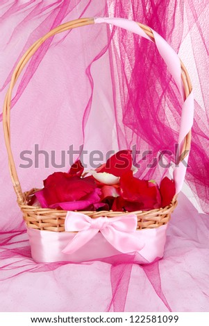 Wedding basket with rose petals
