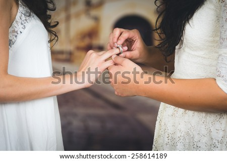 wedding beautiful lesbian couple in love getting married concept of marriage equality - stock photo
