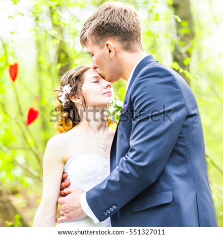 Wedding, Beautiful Romantic Bride and Groom Kissing and Embracing outdoors