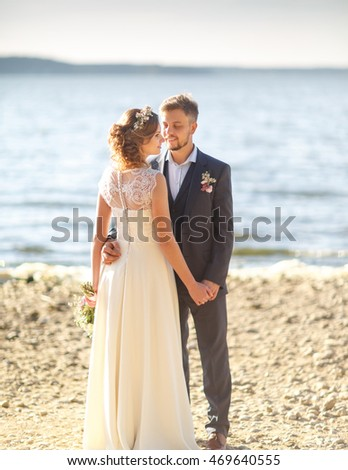 Wedding. Beautiful romantic couple stand near the sea.