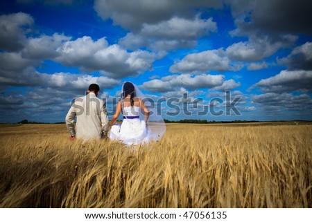 wedding begining of new life fertility among rye fields - stock photo