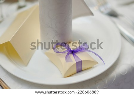wedding bonbonniere box with purple bow. - stock photo