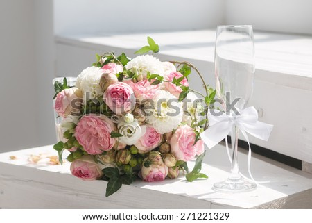 Wedding bouquet and champagne glass - stock photo