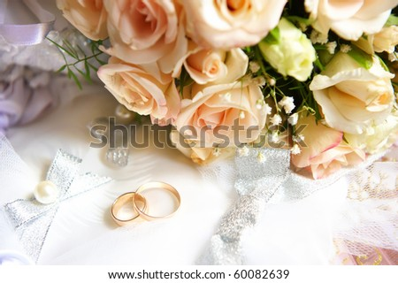 Wedding bouquet and rings. - stock photo